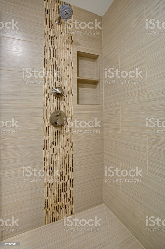 Chic Walk-in shower with beige subway tiled interior stock photo