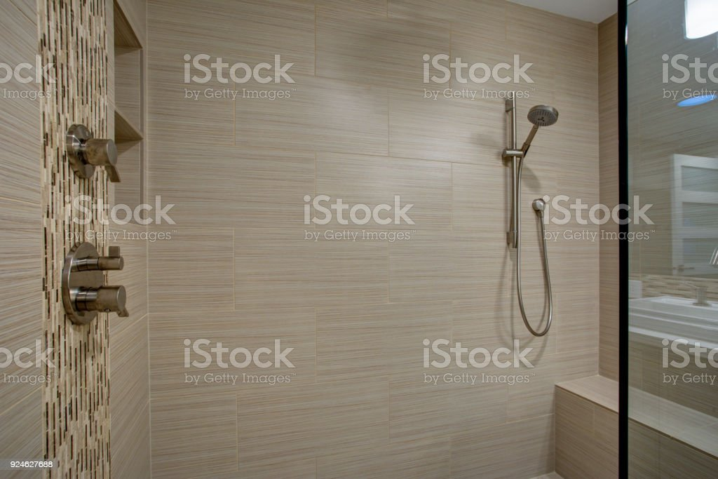 Chic Walk-in shower with built-in bench stock photo