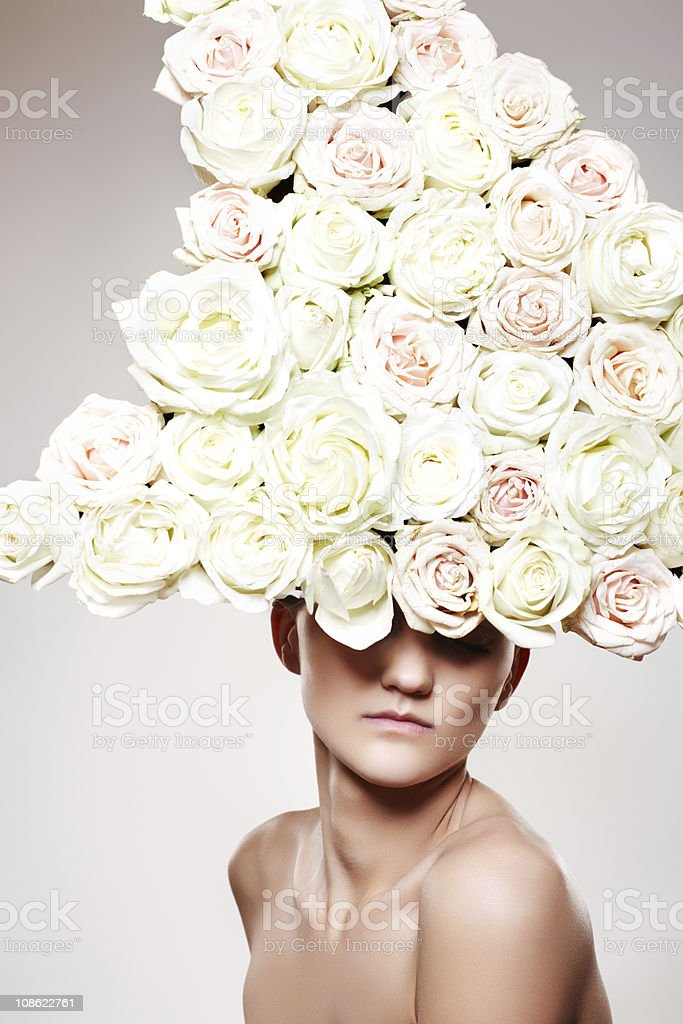 Chic woman with a white rose headwear stock photo