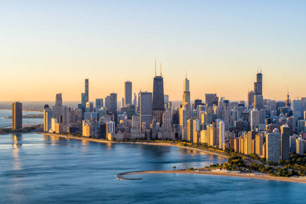 Chicago Aerial Cityscape at Sunrise Aerial View of Chicago Lake Shore Dr at sunrise in Autumn - October 2019 chicago stock pictures, royalty-free photos & images