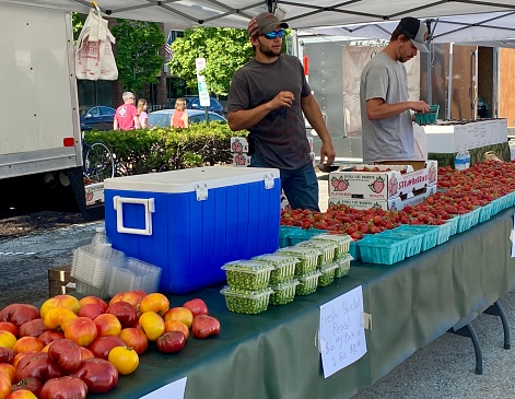 Winnetka, IL, USA - June 12 2021: Farmers Markets in Illinois are open with shoppers and vendors unmasked as the state lifts COVID restrictions.