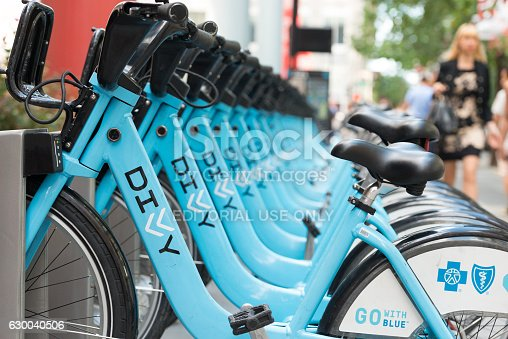 Chicago, USA - August 23, 2016: Divvy bikes in a row at a rental station along Michigan Avenue early in the morning.