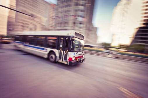 Panning photo of a Chicago Bus. The photo was postprocessed, by partial desaturation, toning, and a vignetting was added to balance composition