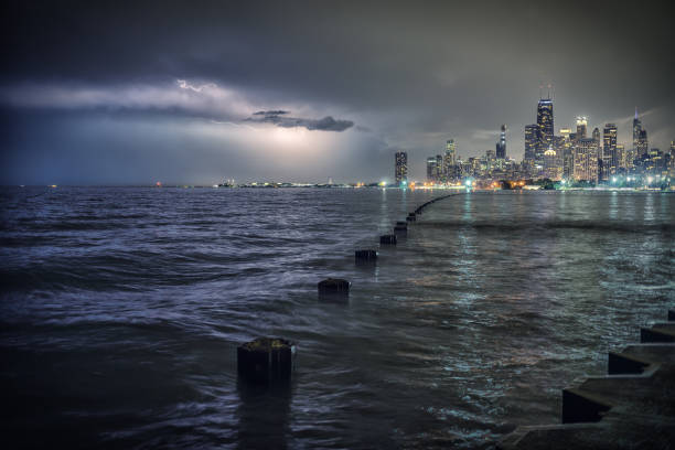 Chicago by Lake Michigan during a lightning thunderstorm at night stock photo