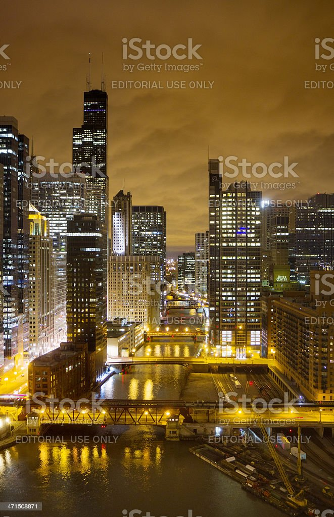 Chicago by Night Chicago, Illinois, USA - April 18, 2013: Nighttime view of downtown Chicago along the South Branch Chicago River. Chicago - Illinois Stock Photo