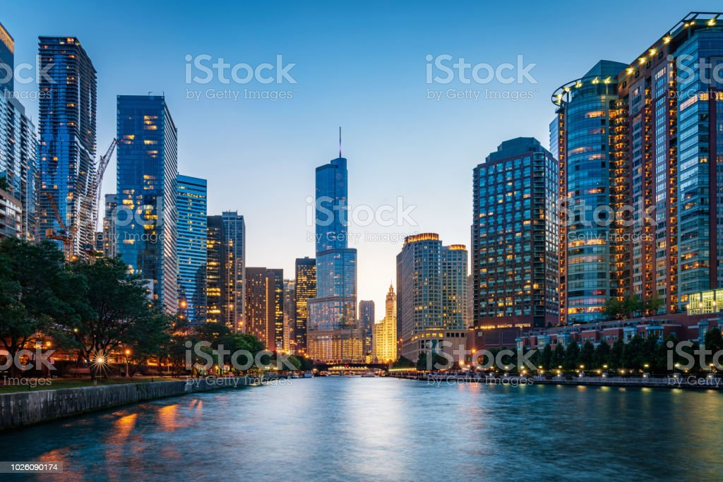 Chicago Cityscape at Dusk Illinois USA Beautiful illuminated Chicago Cityscape from Chicago River Waterfront at Dusk. Long time exposure. Chicago, Illinois, USA. Apartment Stock Photo