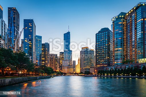 Beautiful illuminated Chicago Cityscape from Chicago River Waterfront at Dusk. Long time exposure. Chicago, Illinois, USA.