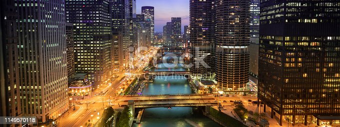Downtown city buildings and panoramic skyline over the Chicago River at night in Illinois USA