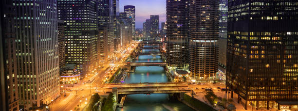Chicago cityscape panorama and bridges over the river at night stock photo
