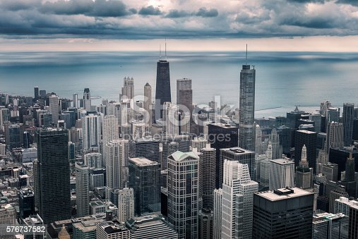Chicago downtown cityscape with skyscrapers, aerial or bird-eyes view, cloudy day. Michigan lake on the background. Illinois, USA. Vintage photo effect