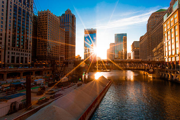 Chicago Cityscape with the Sun A wide-angle capture of Chicago cityscape by the Merchandise Mart. bascule bridge stock pictures, royalty-free photos & images