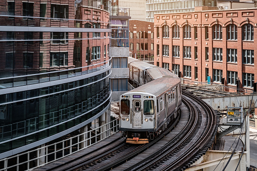 Chicago Cta Train Between City Buildings Stock Photo - Download Image Now