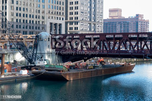 483312814 istock photo Chicago - december 7 2013: bridges over the chicago river, born in lake michigan, panoramic view of modern city, first world architecture. 1176404359