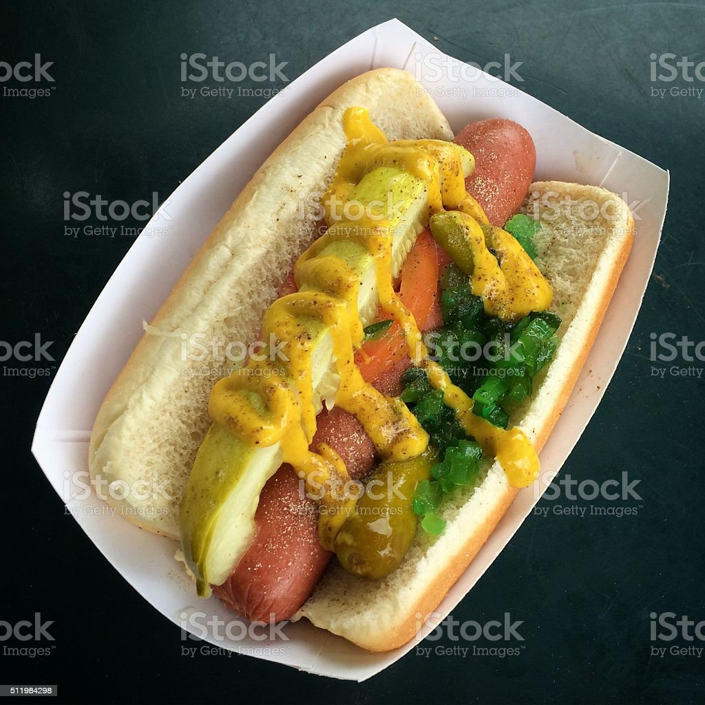Chicago hot dog classic style Chicago hot dog classic style in a white cardboard box on dark background American Culture Stock Photo