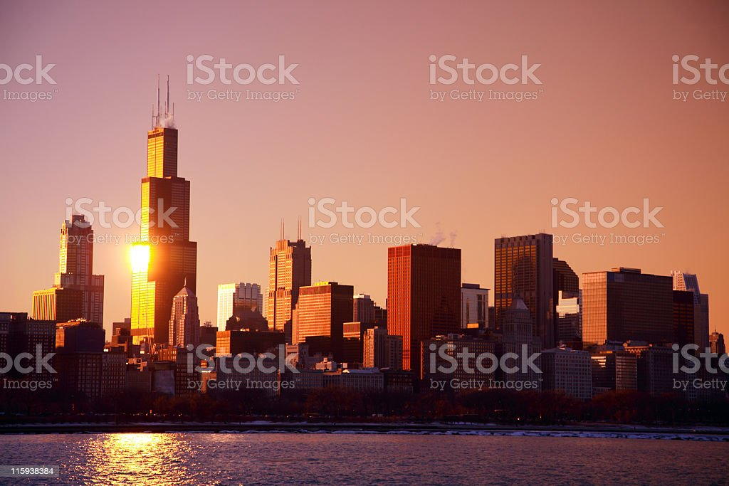 Chicago, Illinois skyline with lake view and sun beaming stock photo
