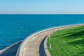 A curving portion of the Chicago Lakefront Trail with no people and Lake Michigan in the South Loop area of Chicago