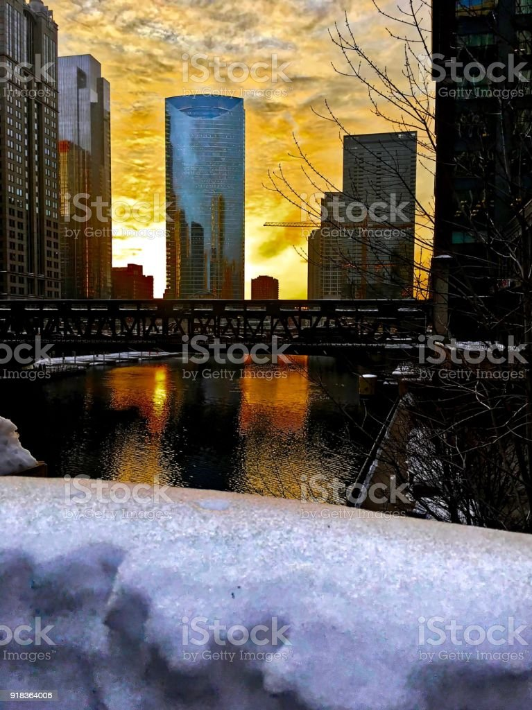 Chicago Loop sunset over a snowy Chicagoland and Chicago River in winter. stock photo