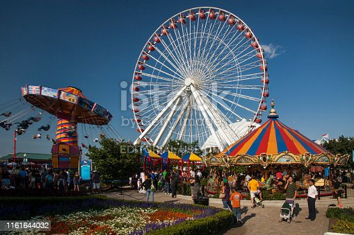Chicago, Illinois: Horizontal shot of the colorful Navy Pier amusement park, with the retro Ferris wheel and carousel, on a beautiful summer day before its last remodeling