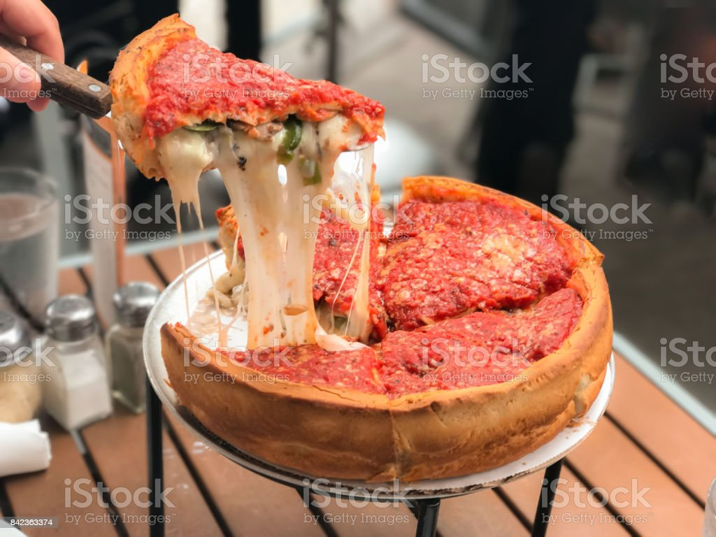 Chicago Pizza filled with cheese. Cheese pizza, Chicago style deep dish italian cheese pizza with tomato sauce. Bacon Stock Photo