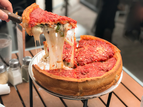 Chicago Pizza Filled With Cheese Stock Photo - Download Image Now