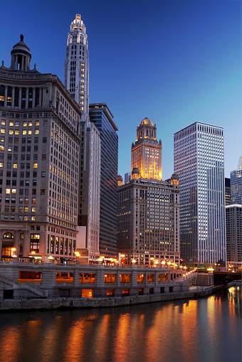 Partial Chicago skyline and river at evening