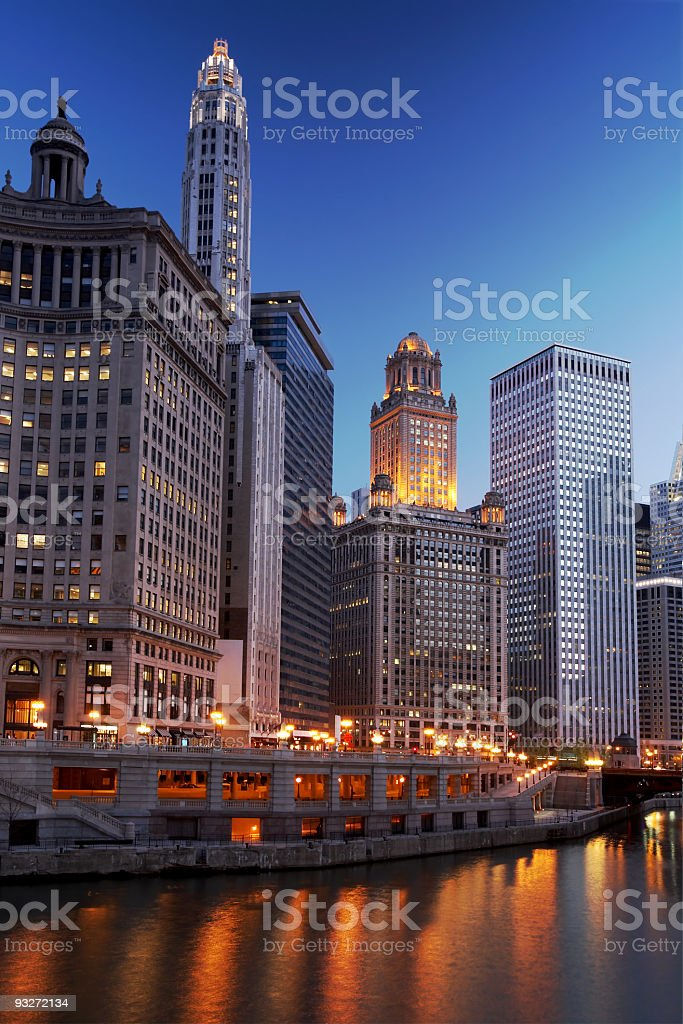 Chicago river illuminated by city lights in late afternoon stock photo