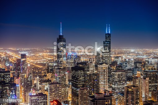 View of futuristic skyscrapers in Chicago at night.