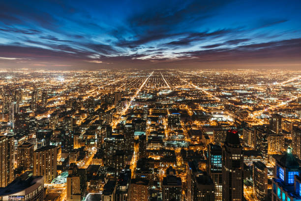 chicago skyline at night - urban sprawl stock photos and pictures