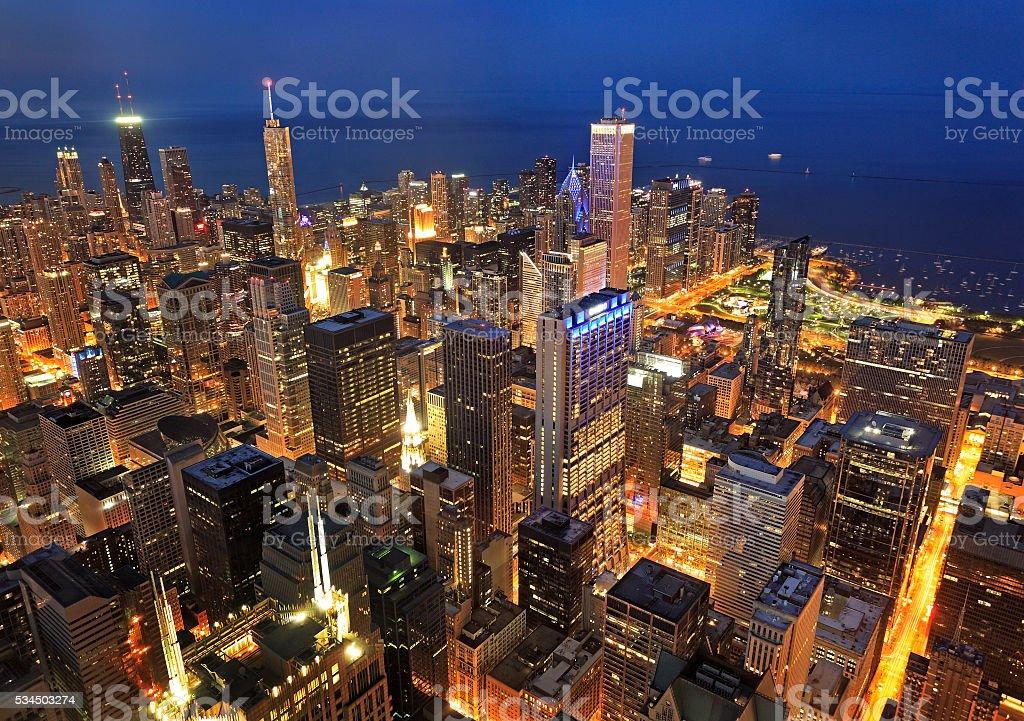 Chicago skyline illuminated at night, aerial view stock photo
