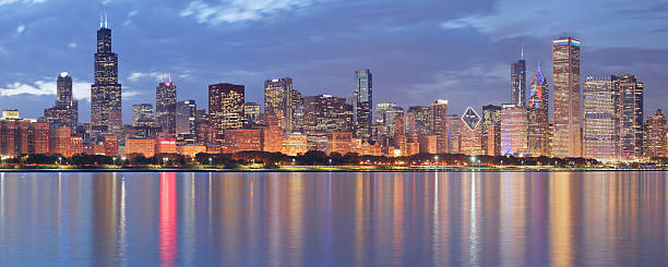 chicago skyline panorama at night - skyline stock photos and pictures