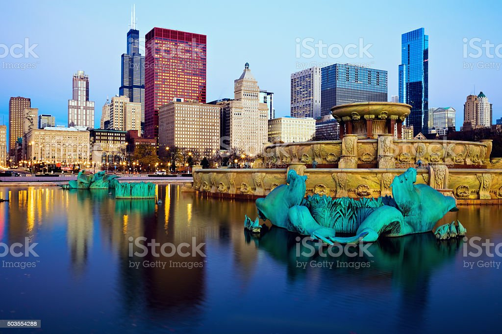Chicago skyline reflected in Buckingham Fountain stock photo