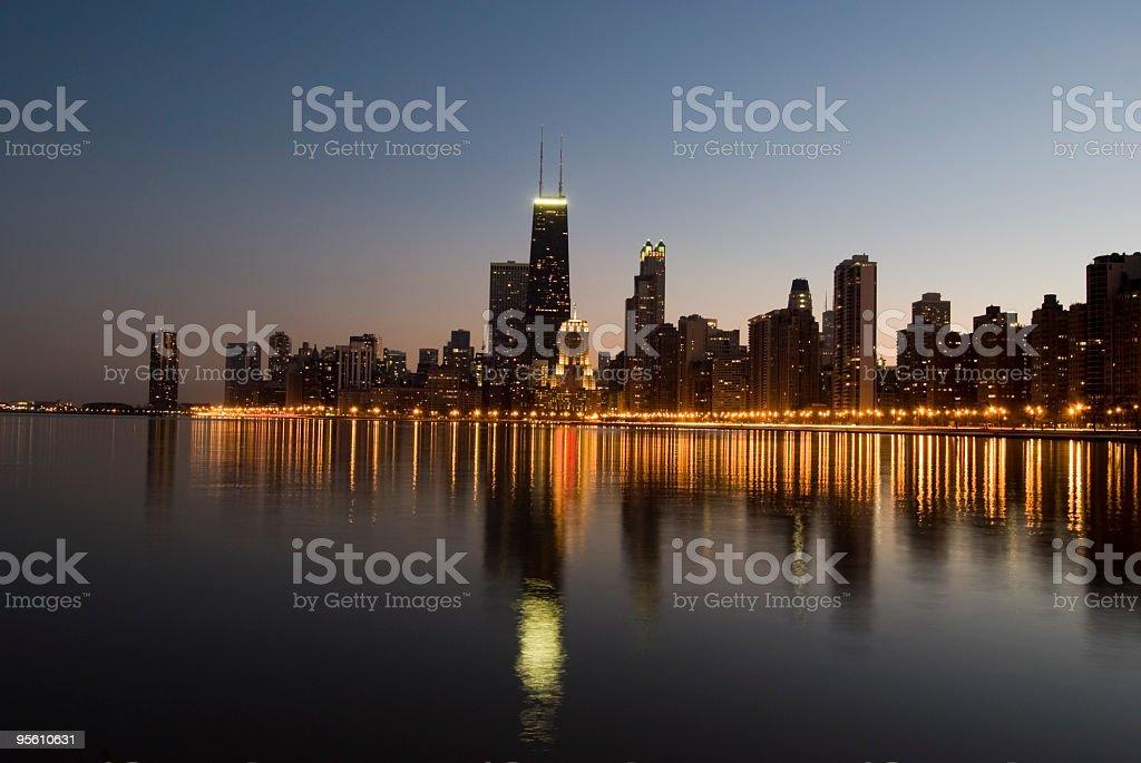 Chicago skyline reflected on Lake Michigan at sunset royalty-free stock photo