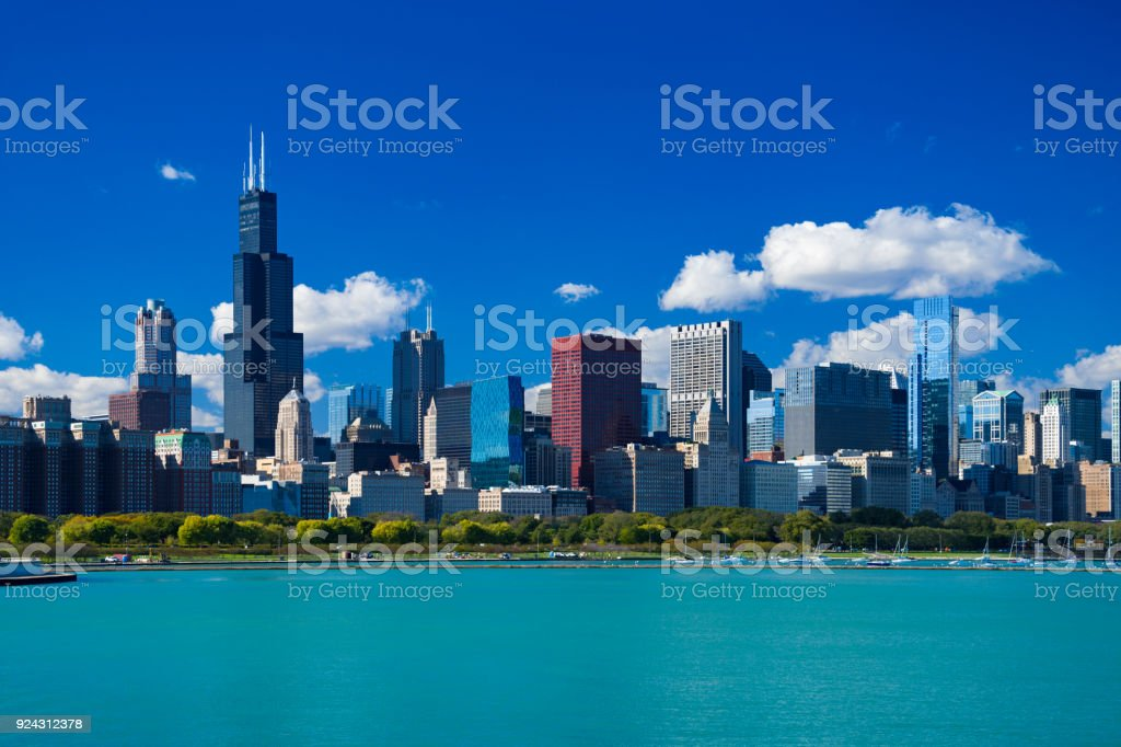 Chicago Skyline With Blue Sky, Cumulus Clouds And Lake stock photo