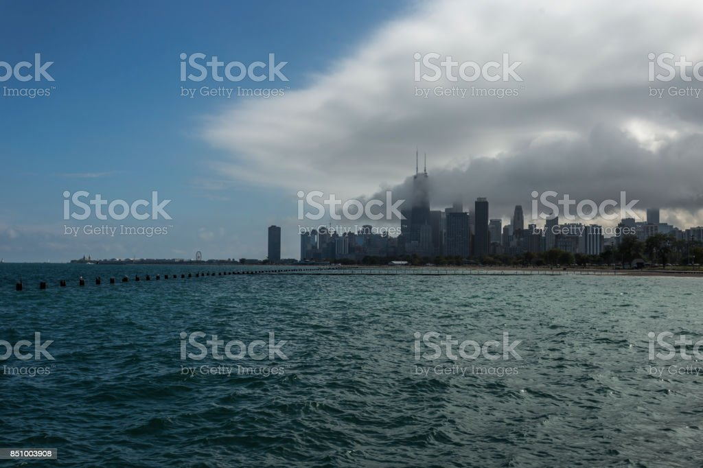 Chicago skyline with lake and clouds stock photo