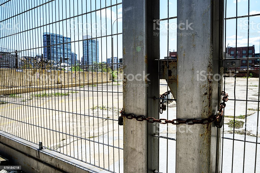 Chicago skyscrapers through padlocked gate stock photo