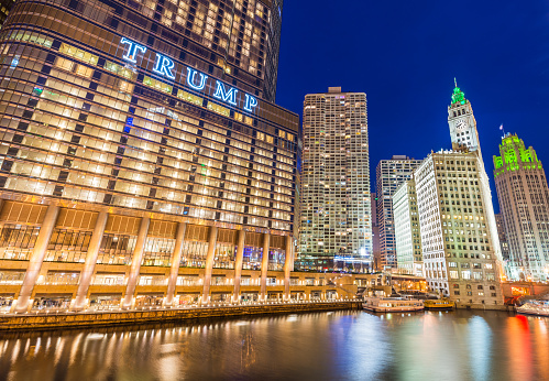 Chicago, USA: Downtown Chicago at night. View of Illuminated buildings in the central part of the city. Trump Tower and The Wrigley Building reflected in Chicago river