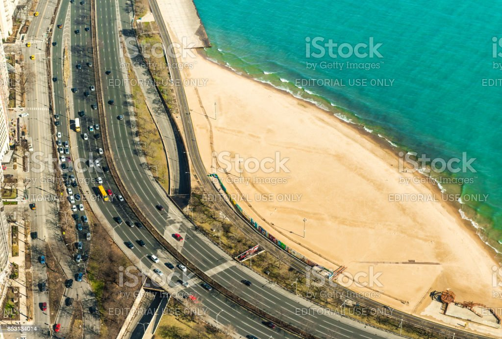 Chicago, USA: View on the highway with traffic, sand beach and the Lake Michigan from the John Hancock Center. stock photo