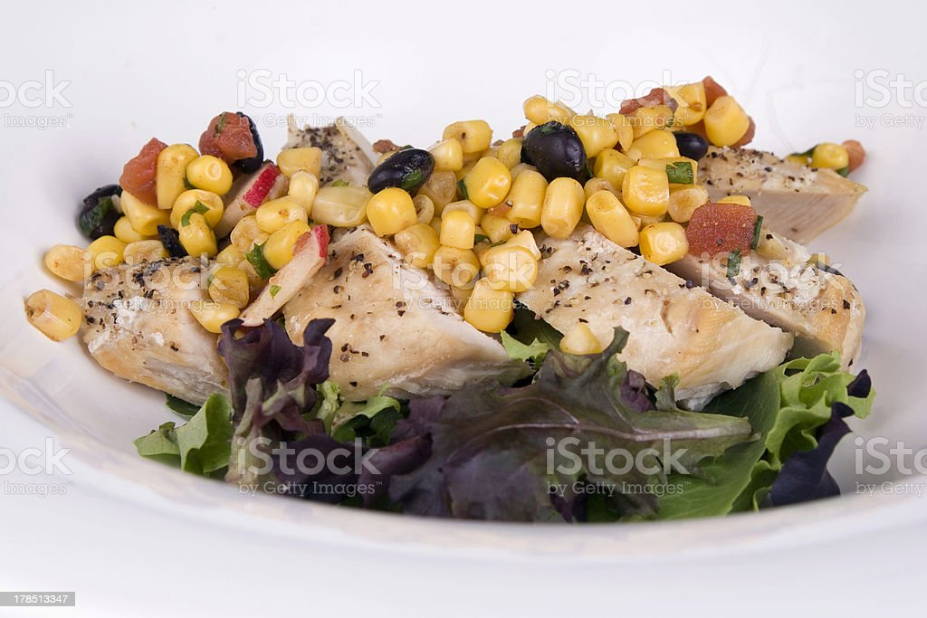 Chichen breast on greens royalty-free stock photo