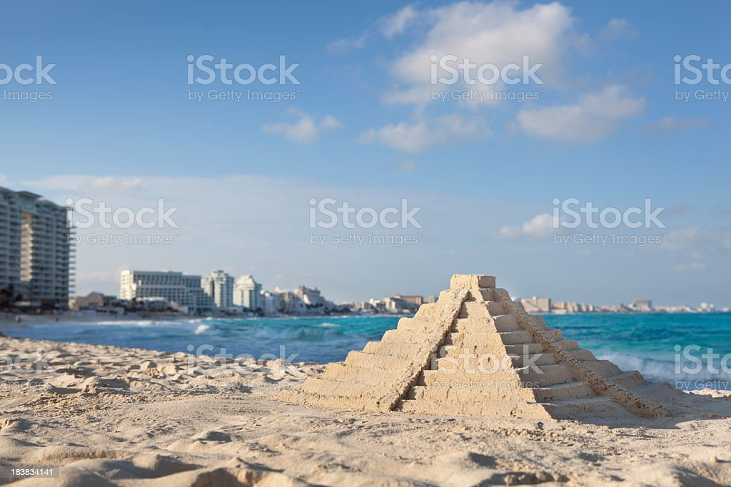 Chichen Itza Sandcastle Pyramid on Topical Hotel Beach, Cancun, Mexico stock photo