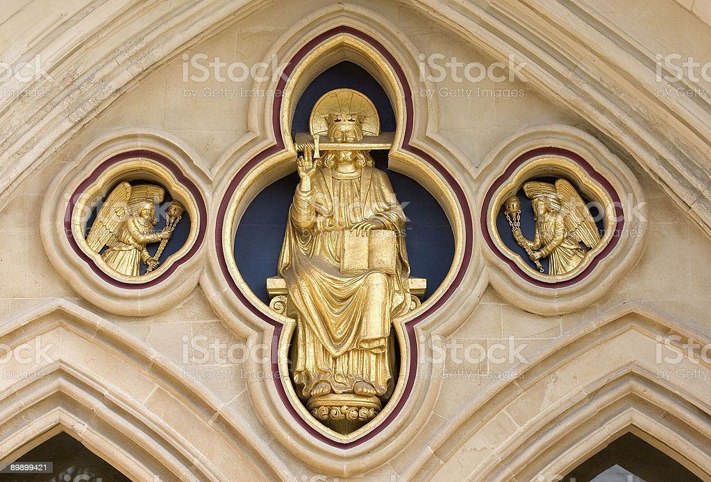 Chichester Cathedral gold religious statue architecture in stone royalty-free stock photo