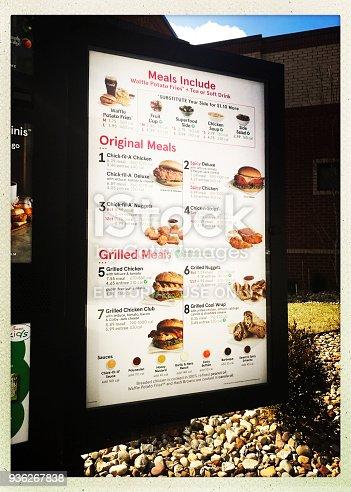 Pittsburgh, USA   March 15, 2018   Chick -Fil-A menu board in drive thru of the McKnight Road restaurant.  iPhone