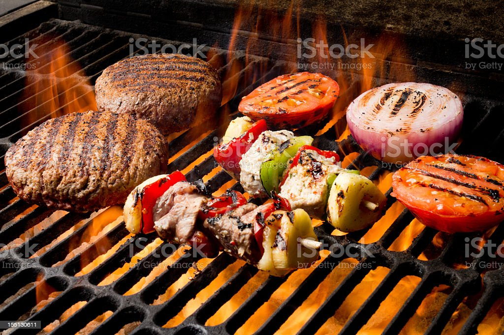 Chicken and Beef Shish Kebabs with Grilled Burger, Tomato, Onion royalty-free stock photo