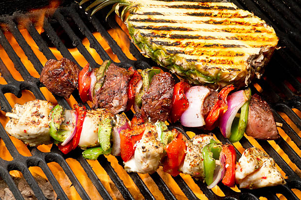 Chicken and Beef Shish Kebabs with Grilled Pineapple stock photo