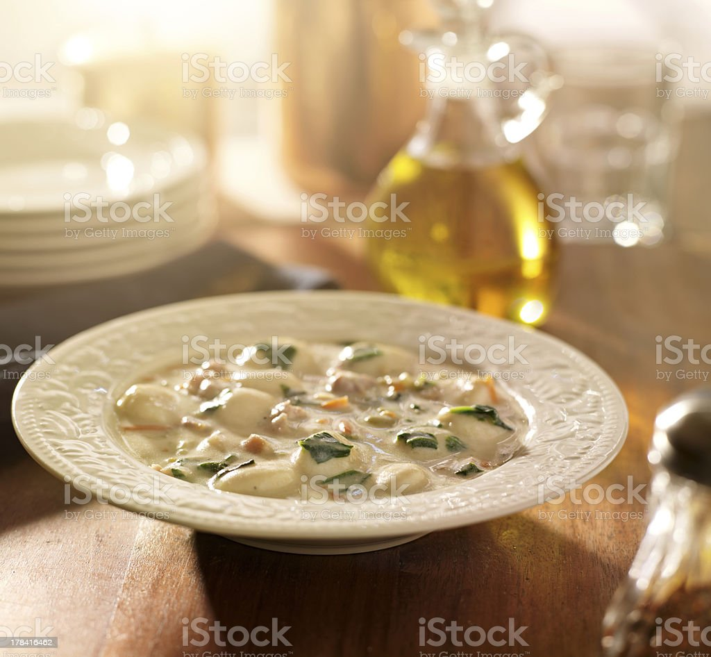 Chicken and gnocchi soup stock photo