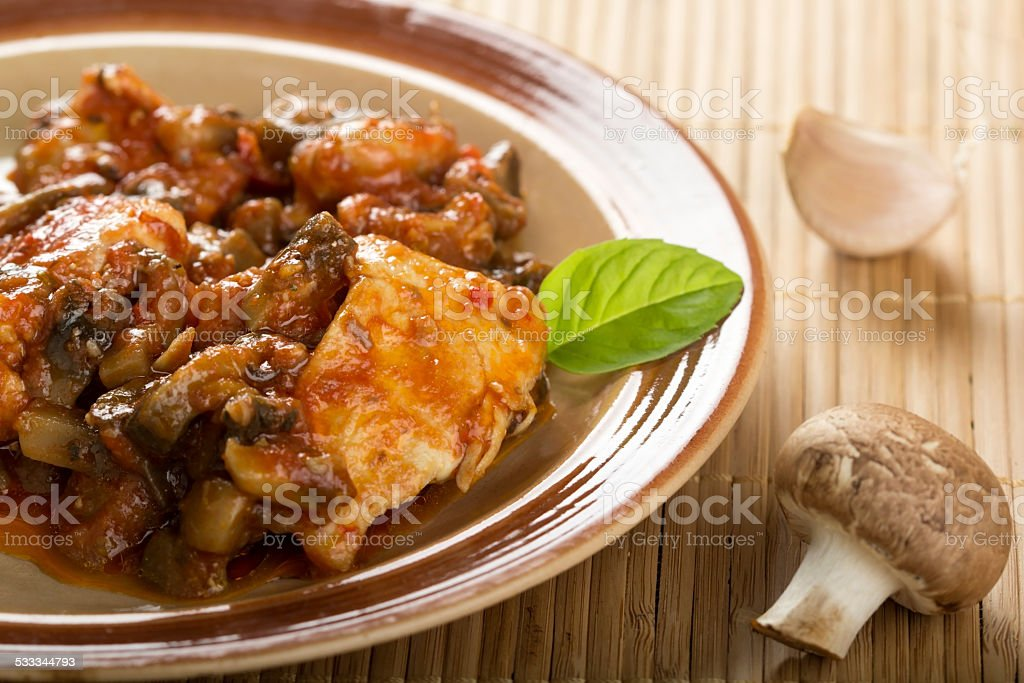 Chicken and mushrooms stock photo