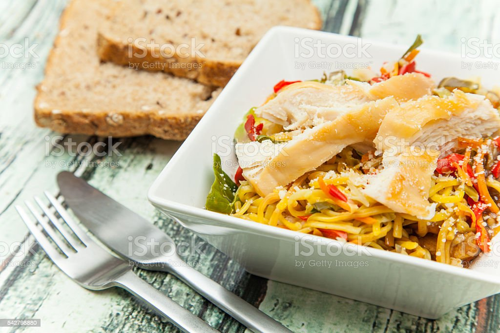 Chicken and noodles stock photo
