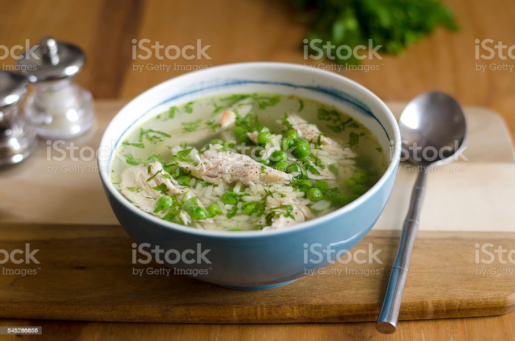 Chicken and pea broth stock photo