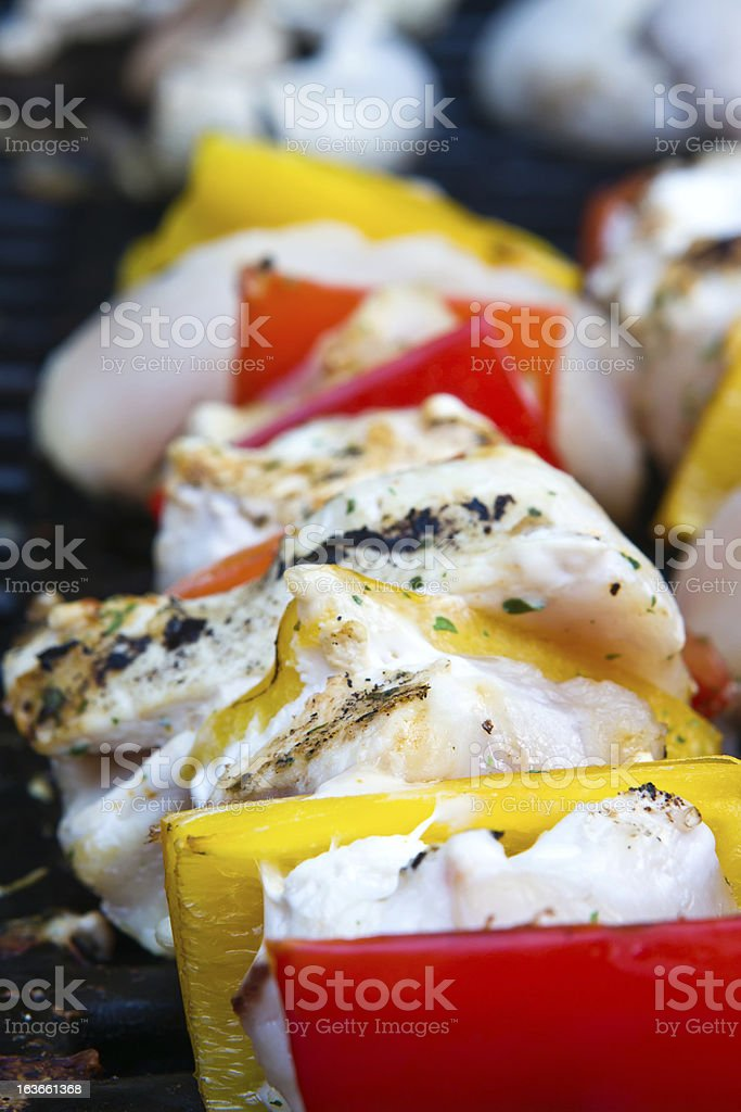 chicken and pepper kebabs slowly cooking on the barbecue royalty-free stock photo