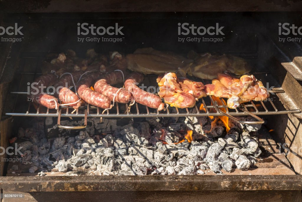 Chicken and sausages barbacue stock photo