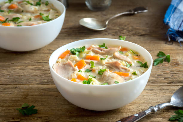 chicken and wild rice soup - chicken rice stock photos and pictures